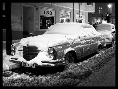 Mercedes Covered with Snow